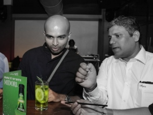 Yours Truly with Glen from Aspri spirits, appreciating Midori with Rosemary and Cucumber