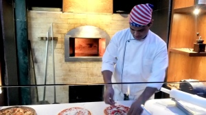 Chef rolling up for the wood fired oven