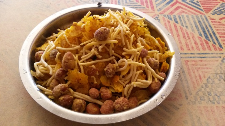 Misal Bhaji ... Coconut , jaggery and chilli flavoured rice flakes/thin poha  doused with coconut gravy and topped  with thick sev and chilli peanuts